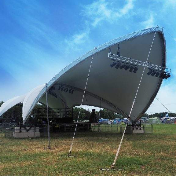 S2000 DuoSpan saddlespan raised on our bespoke base extensions for a festival stage cover