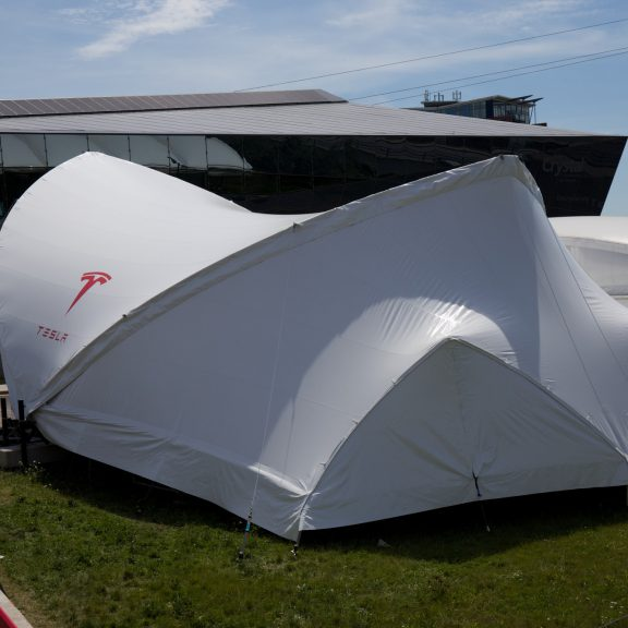 S2000 SaddleSpan Concert outdoor event structure raised on base extensions with bespoke branding