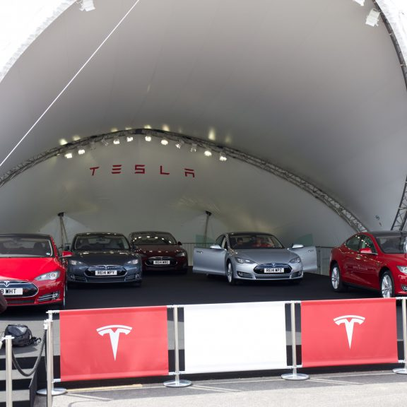 S2000 SaddleSpan Concert outdoor temporary event structure raised on base extensions with bespoke branding for Tesla